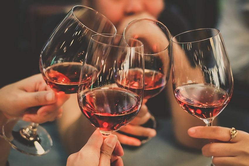 4 glasses celebrating with wine