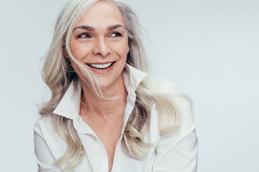 mature woman smiling, showing off her amazing smile